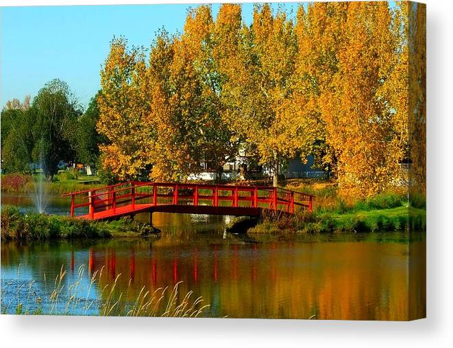 Red Bridge Canvas Print featuring the photograph Bridge Over Placid Waters by Rose Szautner