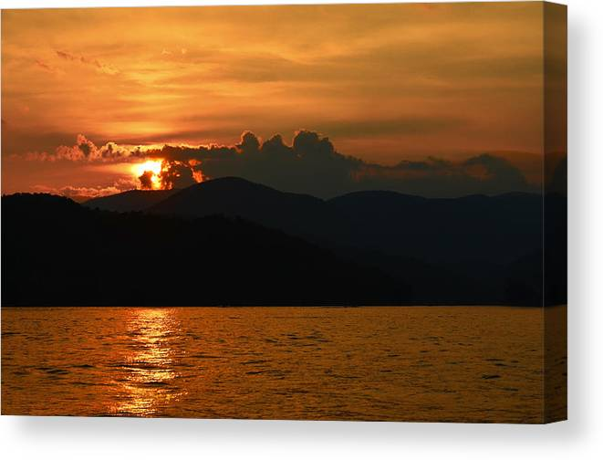 Sunset Canvas Print featuring the photograph Day Ends In Orange by Susan Leggett