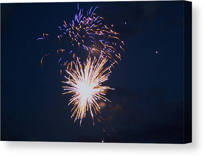 Firework Canvas Print featuring the photograph Fireworks by Robbie Basquez