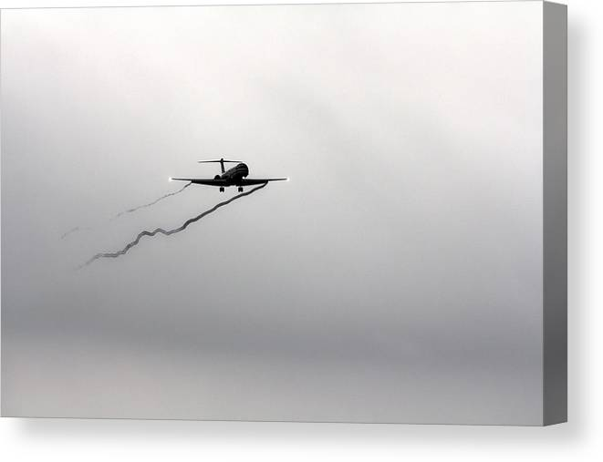 American Airlines-the Mcdonnell Douglas Md-81/82/83/88 Canvas Print featuring the photograph Landing Approach In Bad Weather by Douglas Barnard