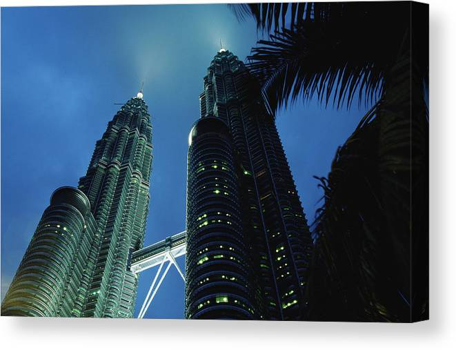 Twin Towers Canvas Print featuring the photograph Petronas, Twin Towers At Night, Low by Axiom Photographic
