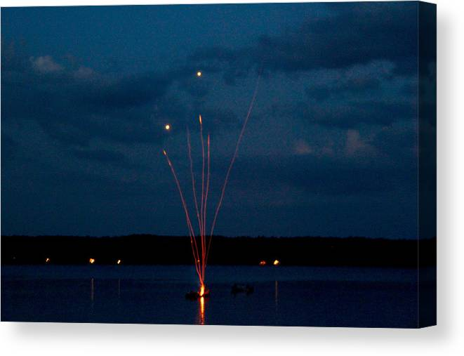 Firework Canvas Print featuring the photograph Shooting Off Dock by Robbie Basquez