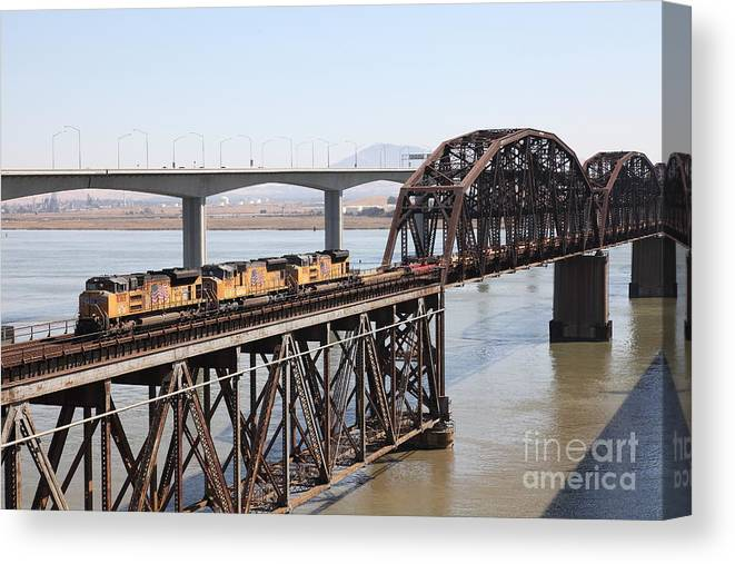 Transportation Canvas Print featuring the photograph Union Pacific Locomotive Trains Riding Atop The Old Benicia-martinez Train Bridge . 5d18850 by Wingsdomain Art and Photography