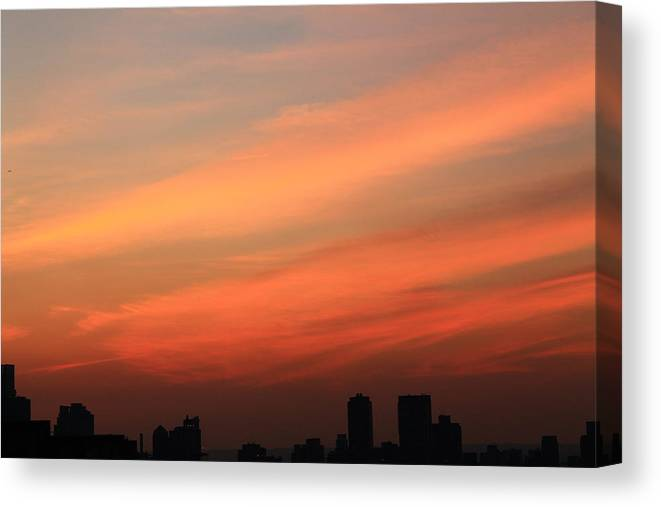 Sunset Canvas Print featuring the photograph Wispy Orange Sky by Catie Canetti