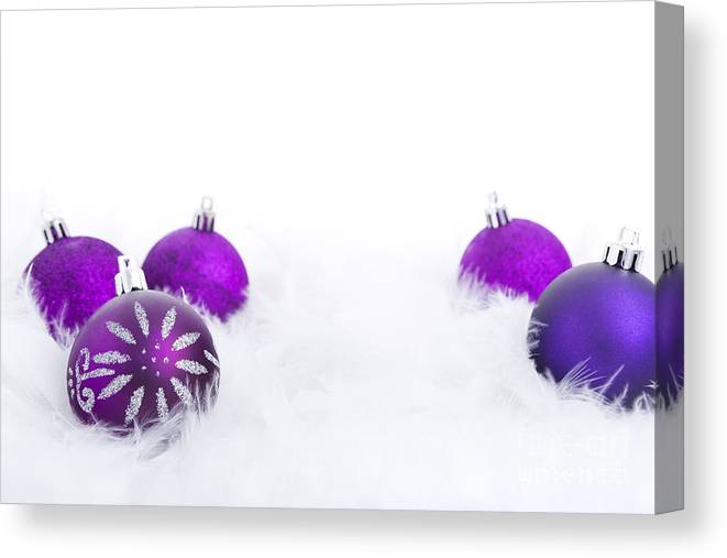 Baubles Canvas Print featuring the photograph Christmas Baubles On A Feathery Surface by Sara Winter