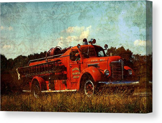 Fire Truck Canvas Print featuring the photograph Old Fire Truck by Off The Beaten Path Photography - Andrew Alexander