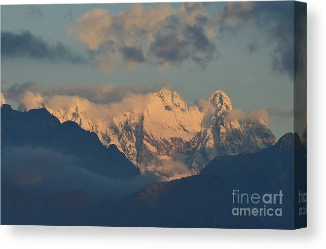 Mountains Canvas Print featuring the photograph Scenic View Of The Dolomites Mountains With A Cloudy Sky by DejaVu Designs