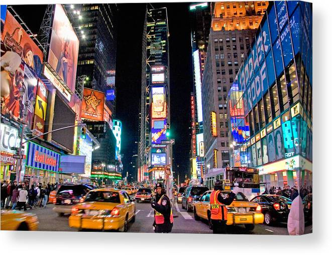 Times Square Canvas Print featuring the photograph Times Square by June Marie Sobrito
