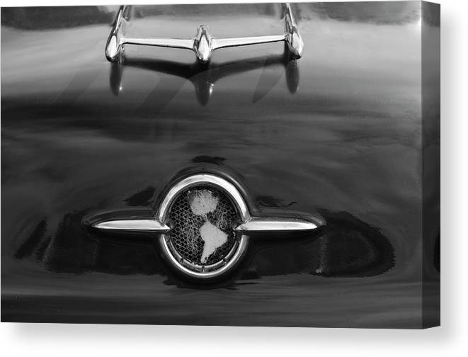 1955 Oldsmobile Holiday 88 Canvas Print featuring the photograph 1955 Oldsmobile Holiday 88 Hood Ornament 2 by Jill Reger