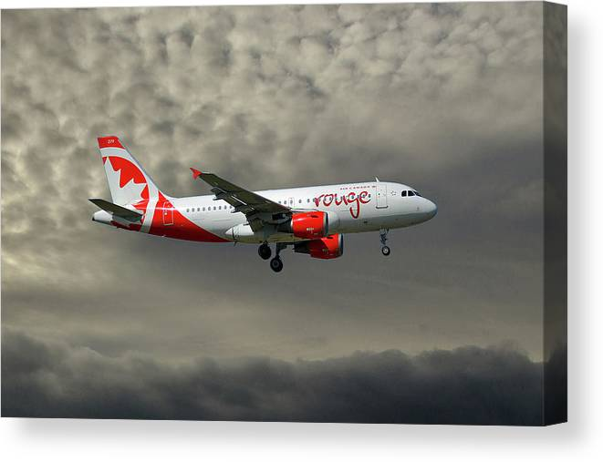 Air Canada Canvas Print featuring the photograph Air Canada Rouge Airbus A319-114 by Smart Aviation