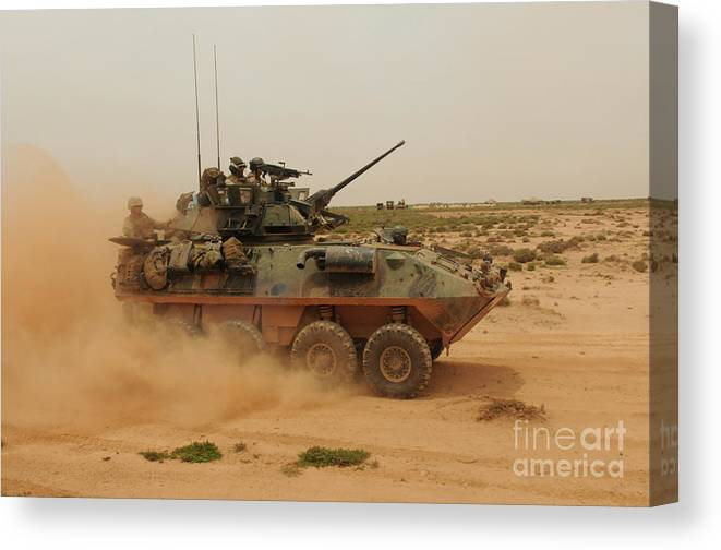 Dust Canvas Print featuring the photograph A Marine Corps Light Armored Vehicle by Stocktrek Images