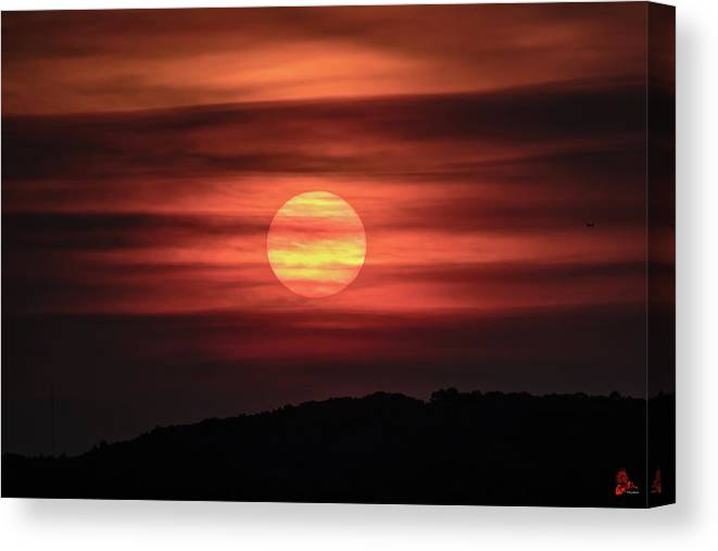 Sunset Canvas Print featuring the photograph A Splash Of Orange by Ronald Raymond