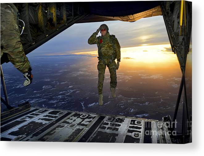 C-130 Canvas Print featuring the photograph A U.s. Soldier Salutes His Fellow by Stocktrek Images