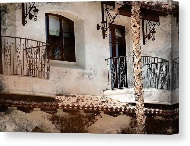 Aged Photograph Canvas Print featuring the photograph Aged Stucco Building Balcony With Terracotta Roof by Colleen Cornelius