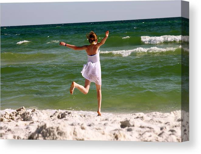 Beach Canvas Print featuring the photograph Beach Jump by Jerry Patterson