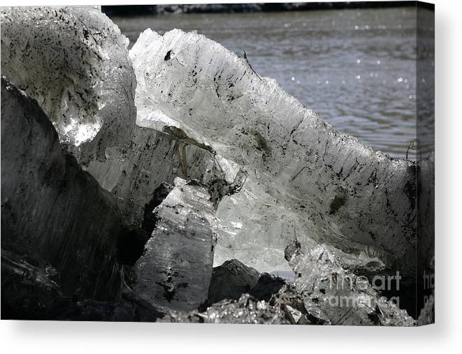 Ice Canvas Print featuring the photograph Broken Ice by Mopics Eu