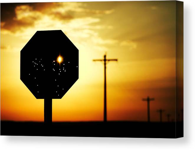 Stop Canvas Print featuring the photograph Bullet-riddled Stop Sign by Todd Klassy