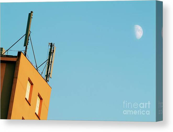 Antenna Canvas Print featuring the photograph Cellular Phone Antennas And A Half Moon At Sunset by Sami Sarkis