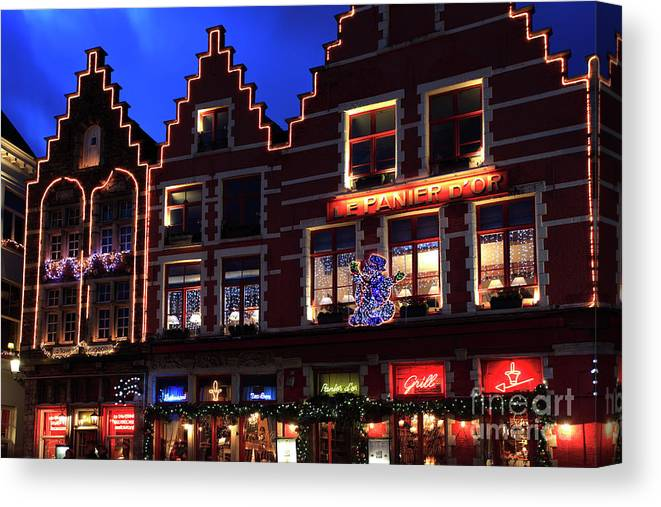 Christmas Decorations Canvas Print featuring the photograph Christmas Decorations On Buildings In Bruges City by Dave Porter