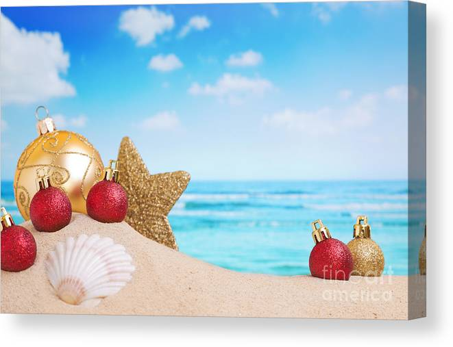 Christmas Canvas Print featuring the photograph Christmas Decorations On The Beach by Sara Winter