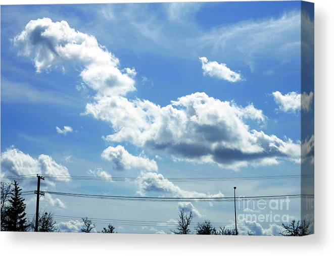 Clouds Canvas Print featuring the photograph Clouds by Mopics Eu