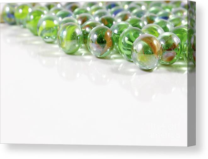Marbles Canvas Print featuring the photograph Composition With Green Marbles On White Background by Daniel Ghioldi