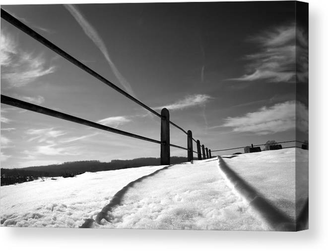 Snow Canvas Print featuring the photograph Divisions by Kevin Brett