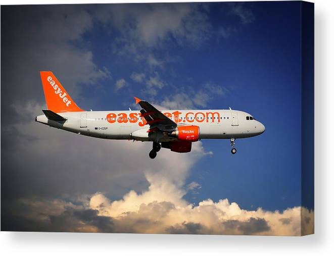 Easyjet Canvas Print featuring the photograph Easyjet Airbus A320-214 by Smart Aviation