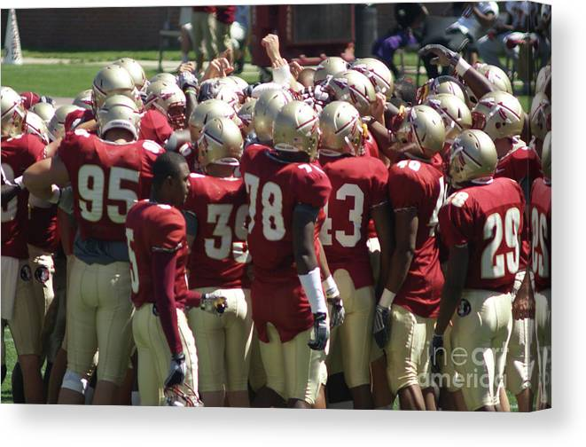 Football Huddle Canvas Print featuring the photograph Fist Pump by Allen Simmons