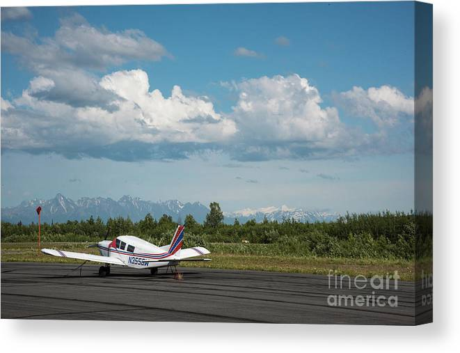 Canvas Print featuring the photograph Flying In Alaska by Paul Quinn