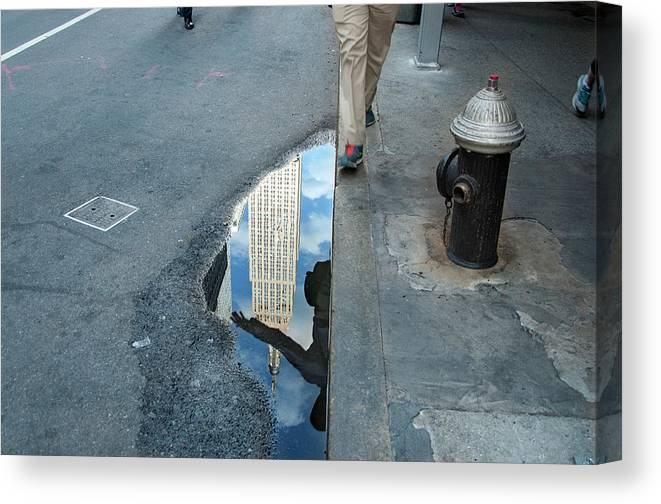 Manhattan Canvas Print featuring the photograph Free In Manhattan - Man Hopping Over A Puddle by Vinayak Garg