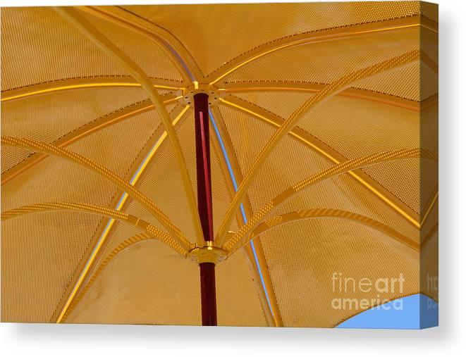 Umbrella Canvas Print featuring the photograph Golden Metal Parasol Umbrella by Merrimon Crawford