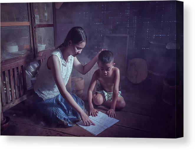 Reading Canvas Print featuring the photograph Happy Family Sisters And Brothers Read Books In The Evening At H by Somchai Sanvongchaiya
