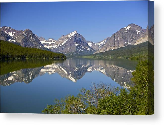 Many Glacier Canvas Print featuring the photograph Lake At Many Glacier by Richard Steinberger