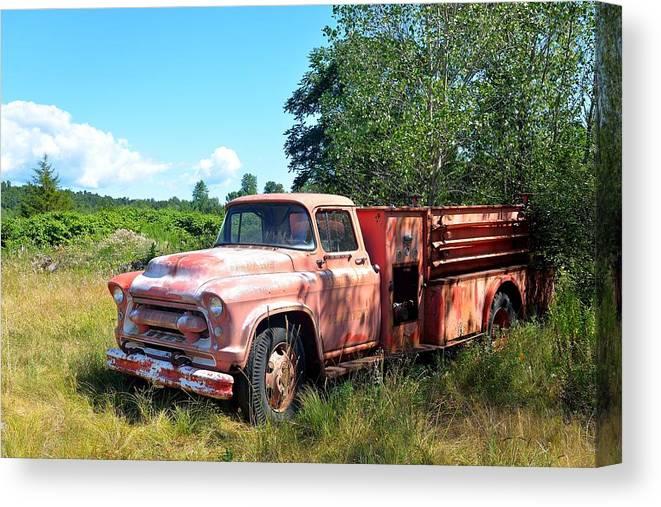 Fire Truck Canvas Print featuring the photograph Left In The Field by Kurt Von Dietsch