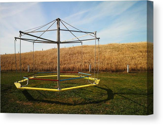 Playground Canvas Print featuring the photograph Merry Go Round On The Prairie by Jeff Swan
