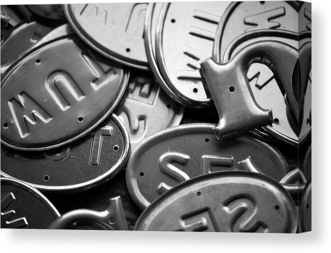Metal Tags Black White Canvas Print featuring the photograph Metal Tags by Kevin Mitts