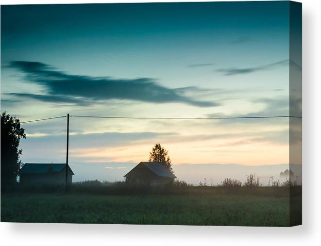 Beauty In Nature Canvas Print featuring the photograph Mist Rises Over The Barn Houses by Jukka Heinovirta