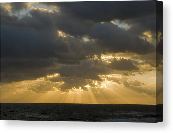 Ocean Sunset Sun Cloud Clouds Ray Rays Beam Beams Bright Wave Waves Water Sea Beach Golden Nature Canvas Print featuring the photograph New Beginning by Andrei Shliakhau