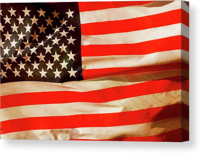 Old Canvas Print featuring the photograph Old Glory Flag In Breeze by Phill Petrovic