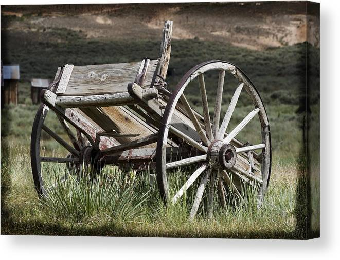 Antique Canvas Print featuring the photograph Old Wheels by Kelley King