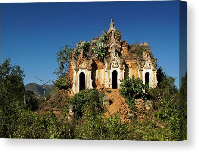 Asia Canvas Print featuring the photograph Pagoda In Ruins by Michele Burgess