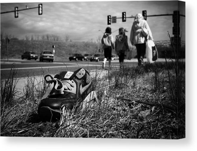 Shoe Canvas Print featuring the photograph Passed by Kevin Brett