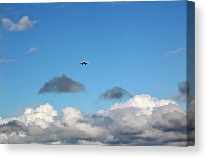 Plane: Through The Clouds Canvas Print featuring the photograph Plane Coming Into Land by Ann O Connell