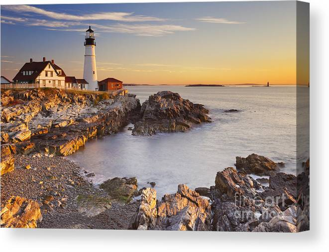 Portland Head Lighthouse Canvas Print featuring the photograph Portland Head Lighthouse In Maine Usa At Sunrise by Sara Winter
