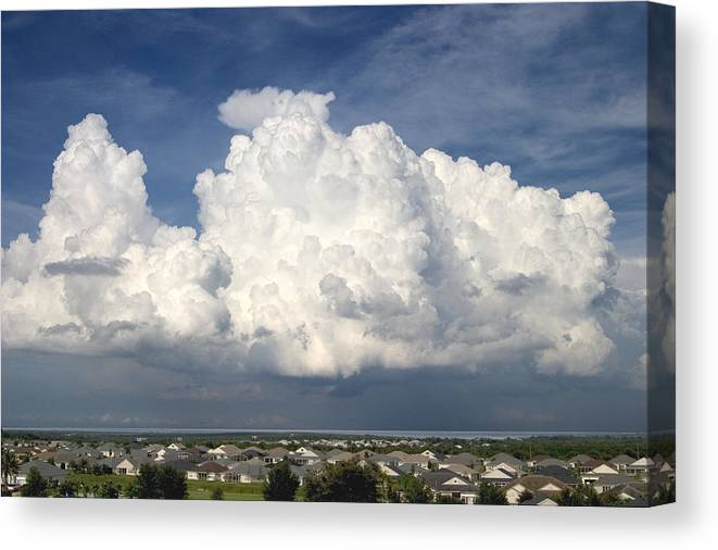 Clouds Canvas Print featuring the photograph Rain Clouds Over Lake Apopka by Carl Purcell