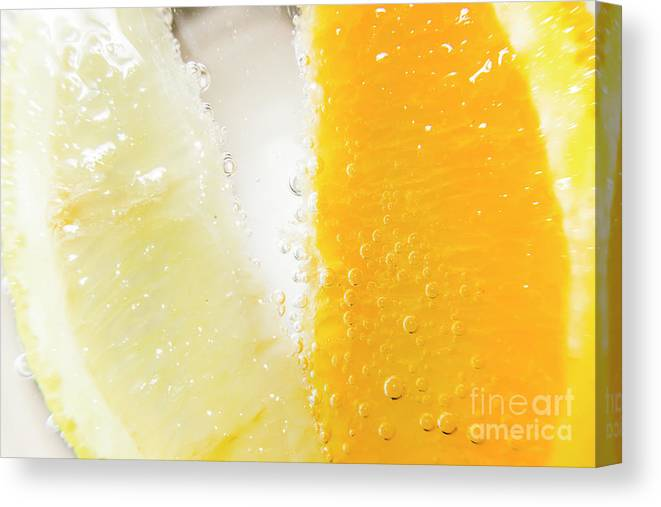 Closeup Canvas Print featuring the photograph Slice Of Orange And Lemon In Cocktail Glass by Jorgo Photography - Wall Art Gallery
