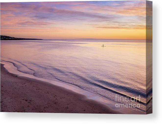 Beach Sunset Canvas Print featuring the photograph Sunset Paddle by Ray Warren