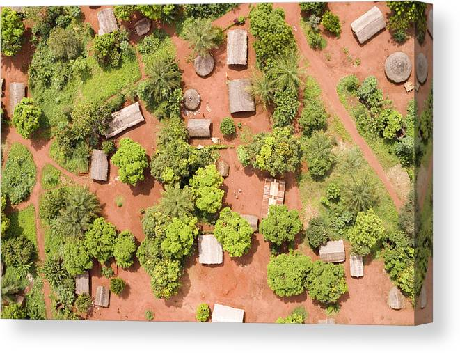 Landscape Canvas Print featuring the photograph The Border Town Village Of Bangassou by Michael Fay