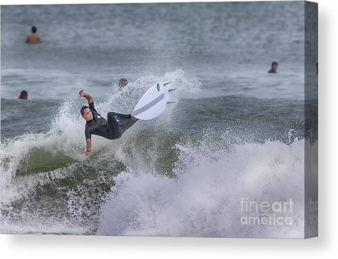 Surfer Canvas Print featuring the photograph The Spray by Deborah Benoit